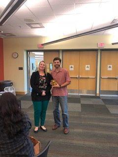 Erin Johnson presenting Past BOD Member Award to Chris Reynolds
