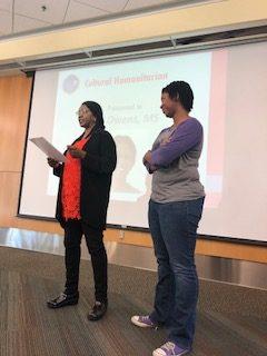 Ruddy Taylor presenting Cultural Humanitarian Award to Xiomara Owens